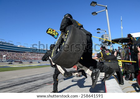 LAS VEGAS, NV - March 07: Pit crew in action at the NASCAR Boyd Gaming 300 Xfinity race at Las Vegas Motor Speedway in Las Vegas, NV on March 07, 2015 - stock photo
