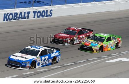 LAS VEGAS, NV - March 08: Ricky Stenhouse Jr 17, leads David Ragan 18 and JJ Yeley 23 at the NASCAR Sprint Kobalt 400 race at Las Vegas Motor Speedway on March 08, 2015 - stock photo