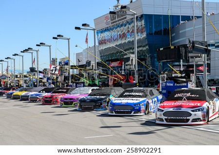 LAS VEGAS, NV - March 08: The cars are lined up for the NASCAR Sprint Kobalt 400 race at Las Vegas Motor Speedway on March 08, 2015 - stock photo