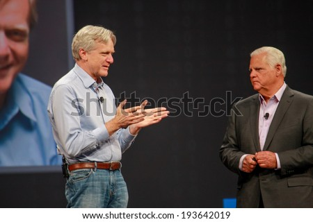 LAS VEGAS, NV -?? MAY 5, 2014: EMC CEO Joe Tucci (right) converses with founder of DSSD company Andy Bechtolsheim at EMC World 2014 conference on May 5, 2014 in Las Vegas, NV  - stock photo