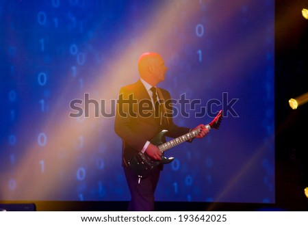 LAS VEGAS, NV -?? MAY 5, 2014: EMC Chief Marketing Officer Jonathan Martin start his speech at EMC World 2014 conference with solo on guitar on May 5, 2014 in Las Vegas, NV  - stock photo
