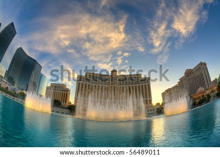 LAS VEGAS, NV - MAY 20:  Fountains at Bellagio Hotel and Casino at sunset. The fountain show is accompanied by lights and popular tunes and runs every 15 or 30 minutes. May 20, 2010, Las Vegas, NV - stock photo