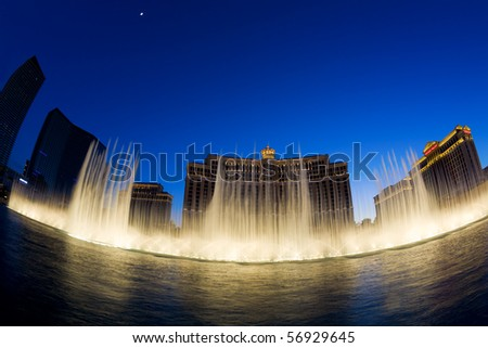 LAS VEGAS, NV - MAY 20:  Fountains at Bellagio Hotel and Casino at sunset. The fountain show is accompanied by lights and popular tunes and runs every 15 or 30 minutes. May 20, 2010, Las Vegas, NV. - stock photo
