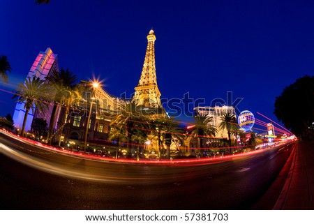LAS VEGAS, NV - MAY 20:  Night street scene with colorful lights featuring Paris and Bally's hotels and casinos on May 20, 2010 in Las Vegas, NV. - stock photo