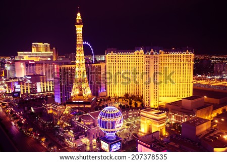 LAS VEGAS, NV -  MAY 7, 2014:  World famous Vegas Strip in Las Vegas seen at night. The Vegas Strip is home to the largest hotels and casinos in the world.  - stock photo