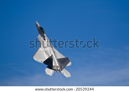 LAS VEGAS, NV - NOV 7:  F-22 Raptor supersonic jet fighter performs at Aviation Nation 2008 Airshow, November 7, 2008 at Nellis AFB, Las Vegas, NV - stock photo