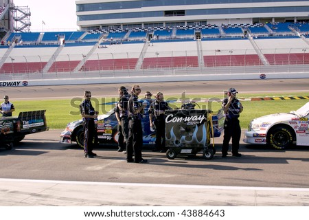 LAS VEGAS, NV - SEPTEMBER 26, 2009: The Con-Way team stages their number 6 Ford for the qualifying of the Sept. 26, 2009 Las Vegas 350 truck race. - stock photo