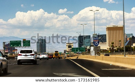 Las Vegas, NV, USA - circa July 2013: Crowded Interstate 15 North with view to Las Vegas strip on the right. - stock photo