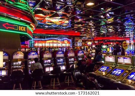 Las Vegas, NV, USA -circa July 2013: People playing slot machine games inside Casino Royale Hotel. - stock photo