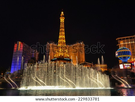 LAS VEGAS, NV/USA - DEC 31, 2013: The Fountains of Bellagio is one of the most breathtaking attractions on the Las Vegas Strip. It's gorgeous, dancing with music, and best of all, free.  - stock photo