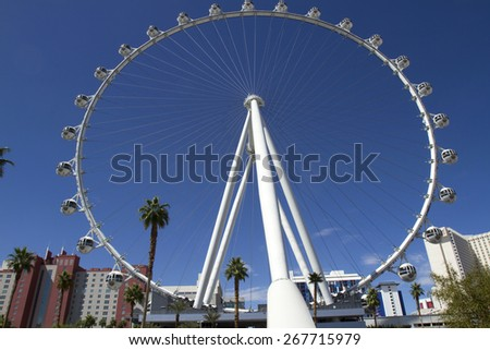 Las Vegas, NV, USA - March 24, 2015 : High Roller ferris wheel on the strip in Las Vegas showing strip hotels against blue sky