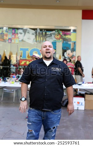 LAS VEGAS -OCT 10: Johnny Jimenez speaks to a crowd . The Toy Shack, on October 10, 2014. Johnny Jimenez is also a toy appraiser on the reality TV show Pawn Stars. - stock photo