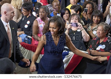 LAS VEGAS - OCTOBER 26: First Lady Michelle Obama with supporters at President Obama`s campaign rally on October 26, 2012 at Orr Middle School in Las Vegas, Nevada. - stock photo