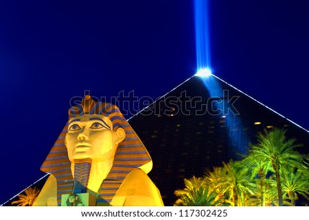 LAS VEGAS - OCTOBER 29: Luxor Las Vegas on October 29, 2011 in Las Vegas. Luxor opened in 1993 and contains a replica of the Great Sphinx of Giza and a pyramid shaped building with a spotlight. - stock photo