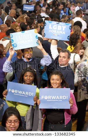LAS VEGAS - OCTOBER 26: Supporters of Barack Obama on a Presidential Election campaign rally at Orr Middle School on October 26, 2012 in Las Vegas, NV - stock photo