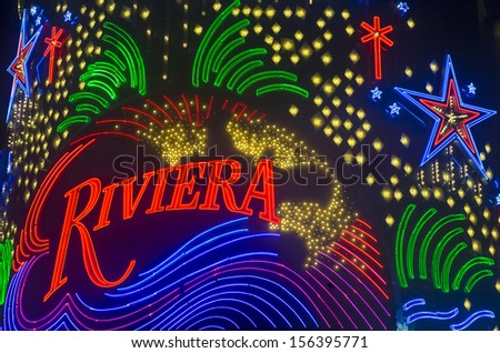 LAS VEGAS - SEP 21: The Riviera hotel and casino sign on September 21, 2013 in Las Vegas. The Riviera opened on 1955 and is one of the first hotel casinos to open in the Las Vegas strip - stock photo