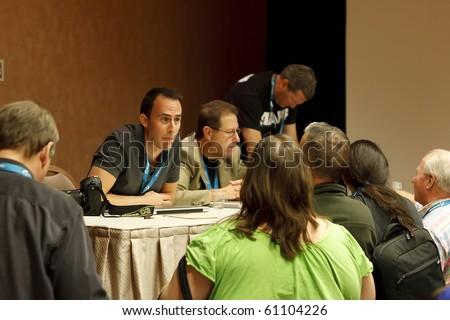 LAS VEGAS - SEPT 2: Educator Matt Kloskowski and editor Scott Kelby at Photoshop World 2010 conference and expo. September 2, 2010 in Las Vegas, Nevada. - stock photo