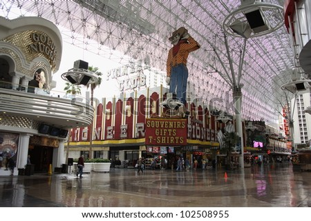 LAS VEGAS - SEPTEMBER 17: Vegas Vic at the former Pioneer Casino on September 17, 2008 in downtown Las Vegas, Nevada. The classic sign was built in 1951 and is part of the Fremont Street Experience. - stock photo