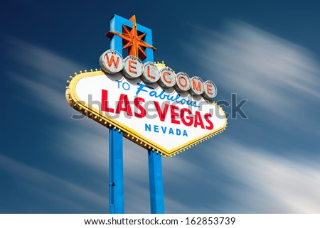 Las Vegas sign against motion blurred clouds. Clipping path included for easy change of background. - stock photo