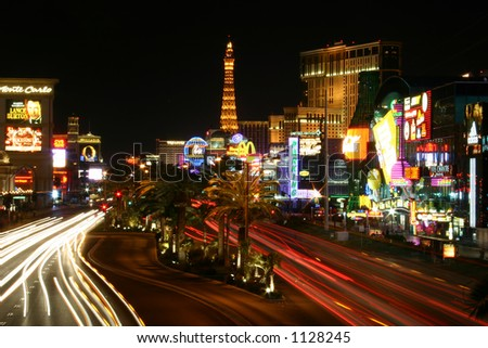 Las Vegas Strip at night with traffic blurred - stock photo