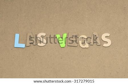 Las vegas text on brown background - stock photo
