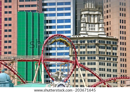 Las Vegas, USA - April 24, 2008: The rollercoaster at the New York, New York hotel in Las Vegas. The cars are at the top of the loop, with people hanging upside down. - stock photo