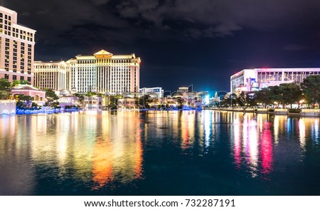 LAS VEGAS, USA - AUGUST 21, 2017: The fountain and pond in front of Bellagio hotel and Caesar's Palace at night time. Editorial.
