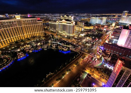 LAS VEGAS, USA - MARCH 18: Aerial view of Bellagio and Caesars Palace hotel and casino with lights on March 18, 2013 in Las Vegas, USA. Las Vegas is one of the top tourist destinations in the world. - stock photo