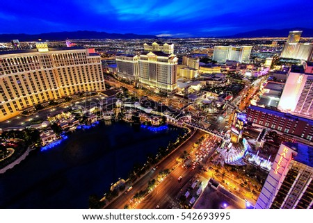 LAS VEGAS, USA - MARCH 18: Aerial view of Bellagio and Caesars Palace hotel and casino with lights on March 18, 2013 in Las Vegas, USA. Las Vegas is one of the top tourist destinations in the world.
