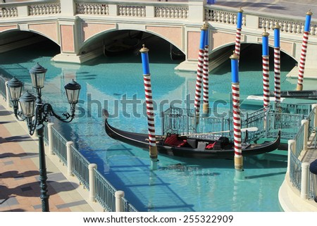 LAS VEGAS, USA - MARCH 19: Gondola in a canal at Venetian Resort hotel and casino on March 19, 2013 in Las Vegas, USA. Las Vegas is one of the top tourist destinations in the world. - stock photo
