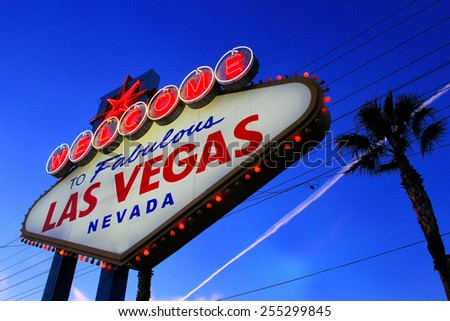 LAS VEGAS, USA - MARCH 19: Welcome to Fabulous Las Vegas sign at sunset on March 19, 2013 in Las Vegas, USA. Las Vegas is one of the top tourist destinations in the world.  - stock photo
