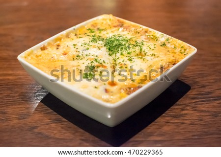 Lasagna in plate on wooden table