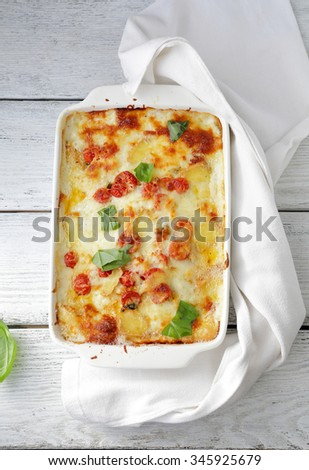 lasagna in white baking dish, top view - stock photo