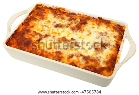 Lasagna uncut in baking dish over white background. - stock photo