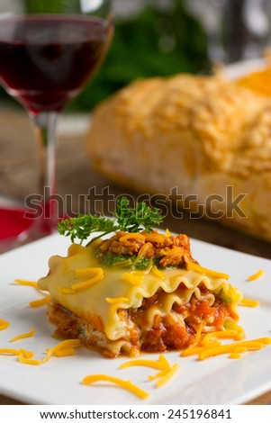 Lasagna with Bolognese Sauce and Pesto Cheese - stock photo
