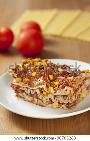 Lasagna with meat, corn and mushrooms - stock photo