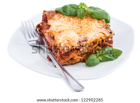 Lasagne on a plate isolated on white background - stock photo