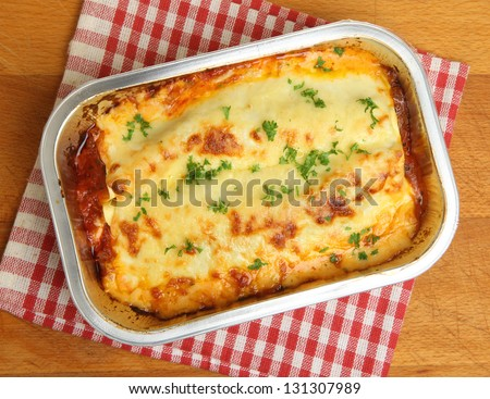 Lasagne ready meal in foil container. - stock photo