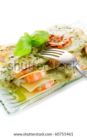 lasagne with shrimp and  pesto - stock photo