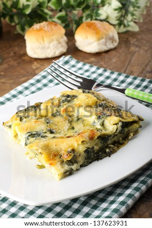 Lasagne with spinach and ricotta on complex background - stock photo