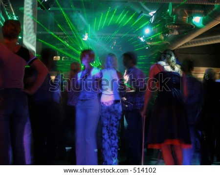 Laser beams at the club - stock photo
