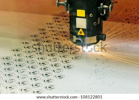 Laser cutter at work - stock photo