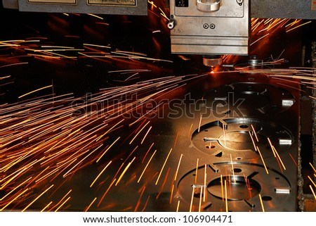 Laser cutting of metal on a lathe with the program. - stock photo