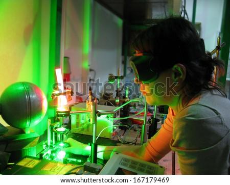 laser experiment - stock photo
