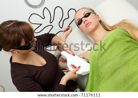 Laser hair removal in professional studio. - stock photo