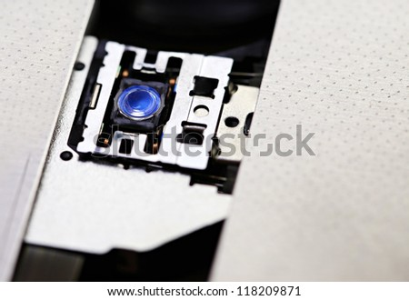 Laser head in DVD rom of notebook - stock photo