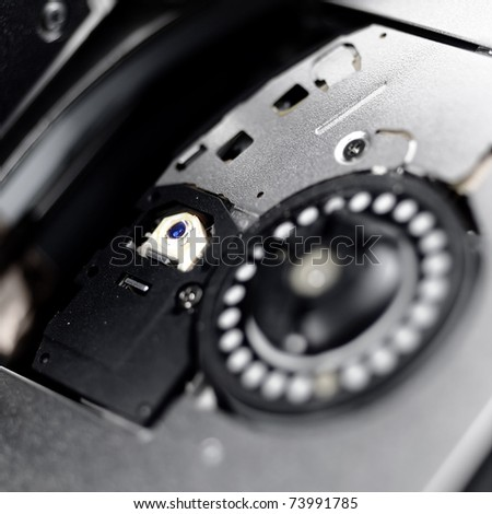 Laser head writes information  to disk Concept of technology and future. - stock photo