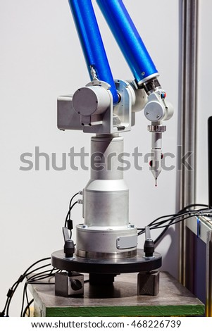 Laser machine for manufacture in industry advanced technology; note shallow depth of field
