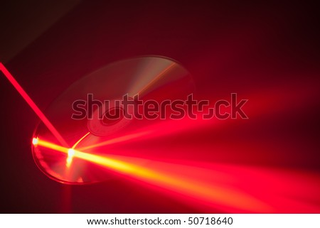laser ray on the disk - stock photo