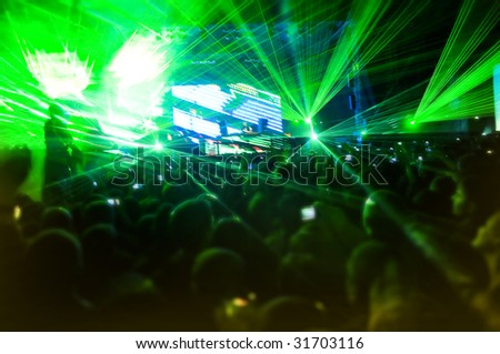Laser show at the concert, blurred motion - stock photo